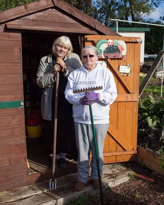 'The absence of growth in early spring means that allotment holders have time on their hands. Across the sites, you can see and hear the gardeners engaged in various preparatory activities, while they await the first shoots of the new season' - Susie Parr  Text and image from 2014 project 'Black Country Allotment Society'  Image: Jenny and Denise, Barnford Park allotments by @emmacase