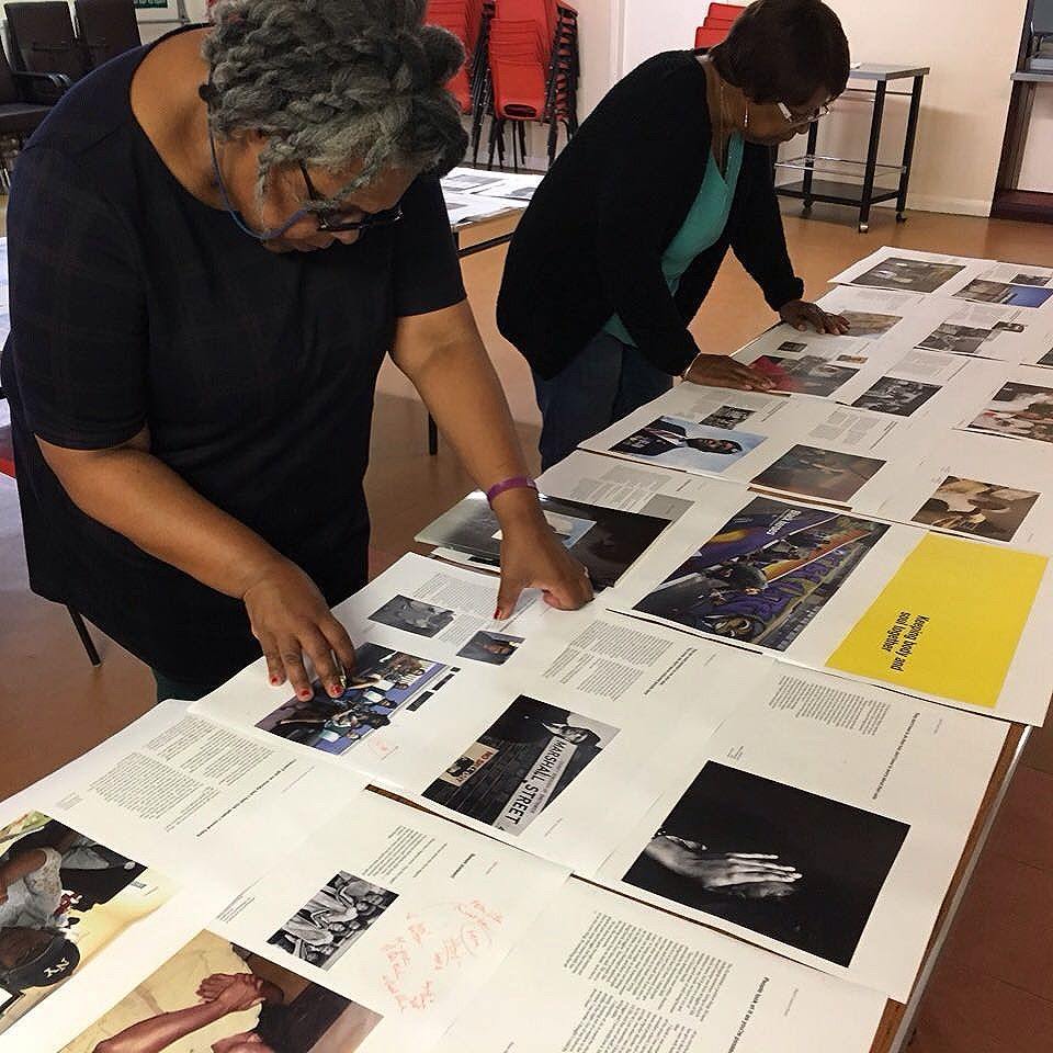 Cllr. Jackie Taylor & Hyacinth Jarrett working with @grahampeet on new @Multistory publication 'Black Country Roots' at the African-Caribbean Centre in West Bromwich.